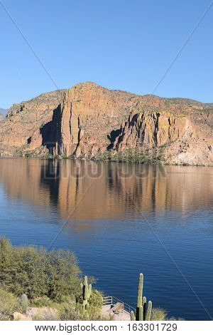 Canyon Lake Arizona in the Tonto National Forest the lake is formed by the Mormon Flat Dam on the Salt River. Vertical image with Saguaro on the closest shore.