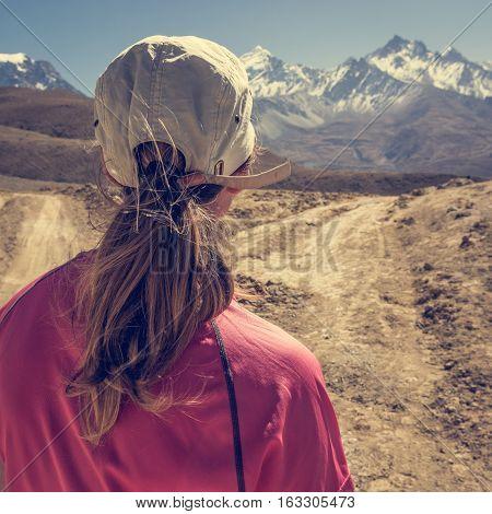 Female hiker deciding which path to take. Annapurna circuit trek.