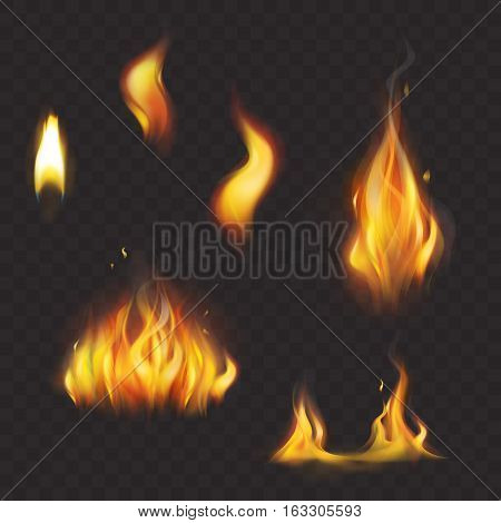 Set of vector colorful realistic flame tongues isolated on a dark plaid background. Collection of light effects, elements for design and decoration