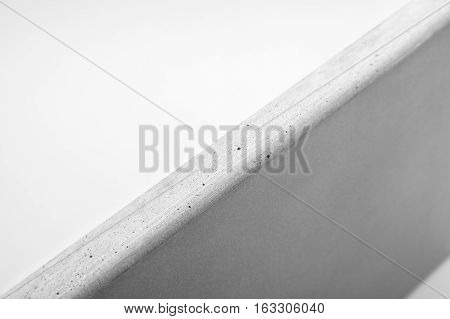 Closeup of natural concrete countertop against a white background
