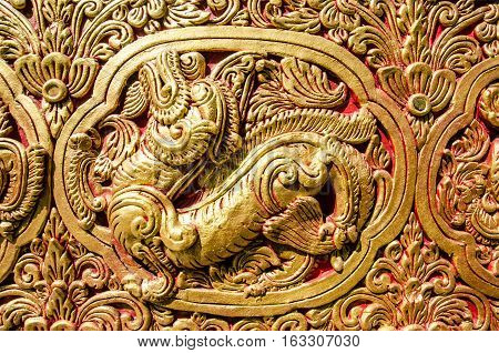 Close Up Beautiful StuccoThai Traditional Art Fantastic Beast or Animal(Lai Thai) Handmade Background Wallpaper Texture
