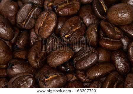 Medium roasted whole coffee beans closeup background