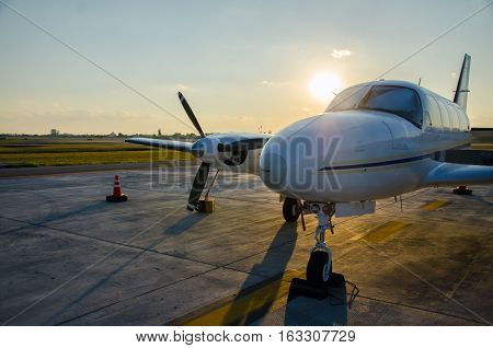 Close up Small Airplane or Aeroplane Parked at Airport.Small Airplane Famous to use Private Airplane.Sunset Light.