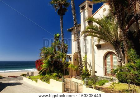 The generic architecture of West Coast Beach homes on Manhattan beach California on a sunny blue sky day.
