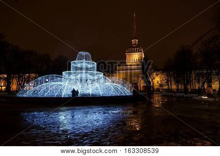 Christmas decoration in the city of St. Petersburg. Fountain of Light. In the background one can see the building of the Admiralty.