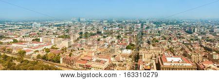Aerial panorama of Mexico City on a sunny morning. Mexico City is a capitol on Mexico. The camera is pointed to East.