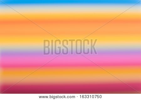 Abstract background from many multi-color straws making striped. Blur.