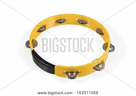 Yellow round plastic tambourine with metal plates isolated on white background