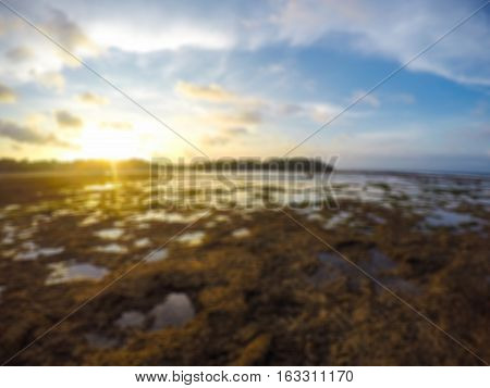 Blur Wide Beautiful View of Sunset at the Beach. People Famous to Vacation in Holiday at Bali Indonesia