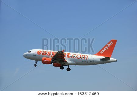 Amsterdam The Netherlands - June 12 2015: G-EZAK easyJet Airbus A319 takes of from Amsterdam Airport Polderbaan runway.