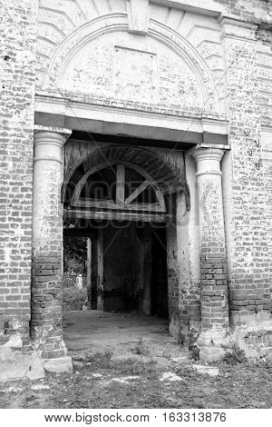 Gate of destroyed Church of St. Nicholas in the village Priluki near Vologda Russia.