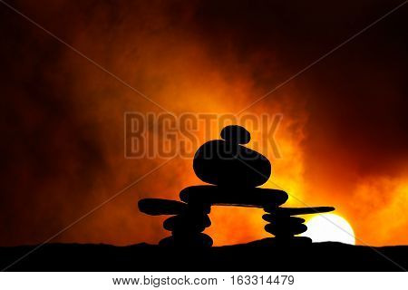 Rock Cairn with Setting or Rising Sun