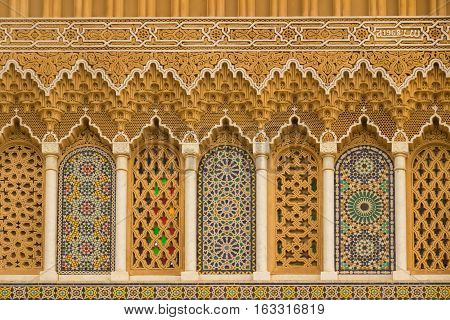 Islamic calligraphy and colorful geometric patterns Morocco.