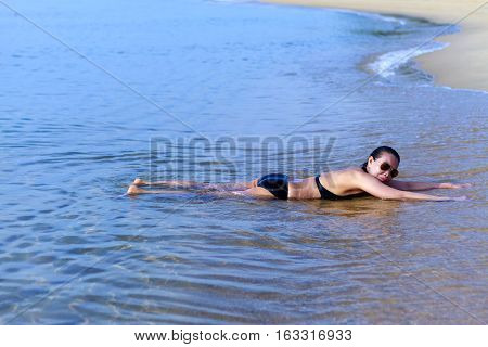 Lady enjoy relax swimsuit in Ban Krut Beach at Prachuap Khirikhun Province Thailand