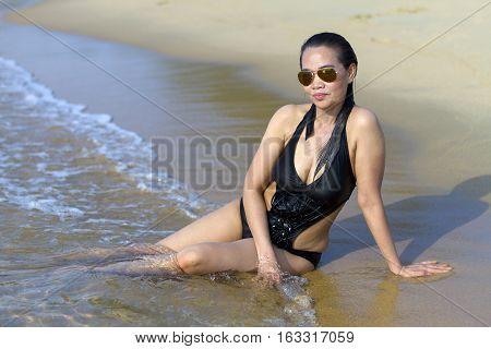 Lady body pretty swimsuit in Ban Krut Beach at Prachuap Khirikhun Province Thailand