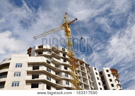 The building is going to building of white brick