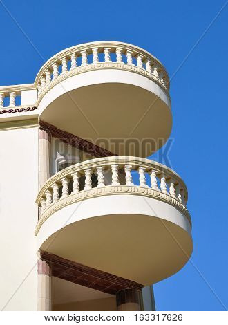 Balconies on the background of a clear blue sky.