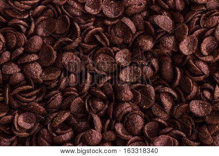 Choco cornflakes closeup background. Healthy nutrition food