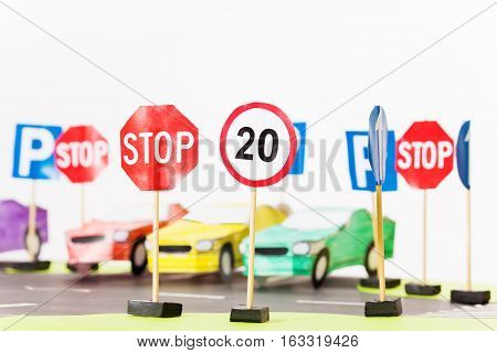 Picture of play set of speed-limit and stop road signs with copy-space
