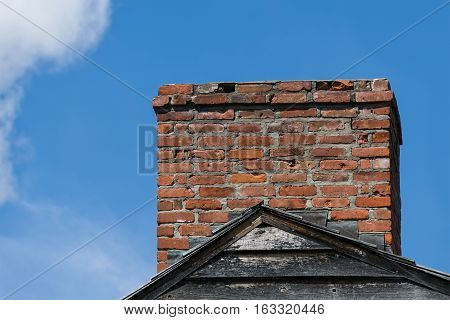 Chimney in Need of Repair on Roof Housetop