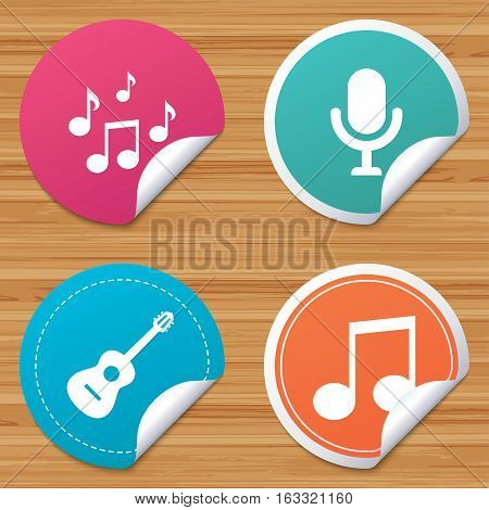 Round stickers or website banners. Music icons. Microphone karaoke symbol. Music notes and acoustic guitar signs. Circle badges with bended corner. Vector