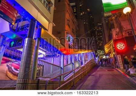 Hong Kong, China - December 10, 2016: Peak bar and Central-Mid-Levels escalator in Shelley and Staunton St, Soho district, Central Hong Kong, famous for bars, restaurants, clubs and nightlife.