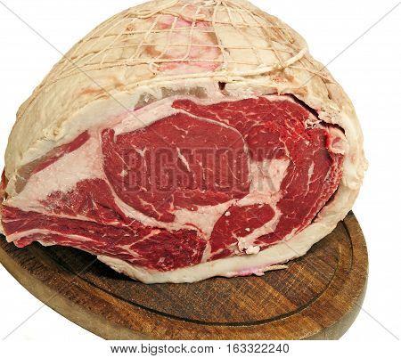 Prime rib roast on a wooden board