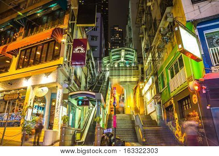 Hong Kong, China - December 10, 2016: entrance of Central-Mid-Levels escalator and Santorini Greek Restaurant in Elgin and Shelley St, Soho district, popular for bars, restaurants and nightlife.