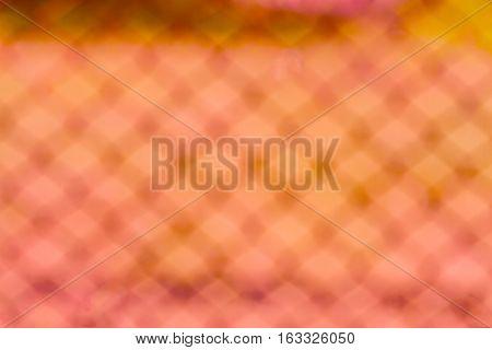 Blurred Yellow wire fence background beautiful bokeh