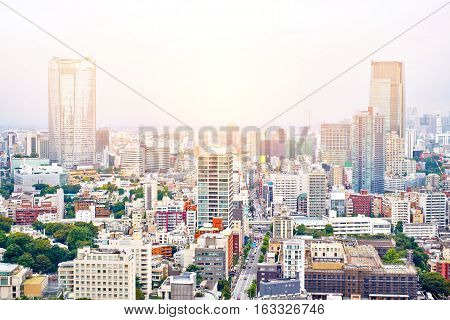 Asia Business concept for real estate and corporate construction - panoramic modern cityscape building bird eye aerial view from tokyo tower under sunrise and morning blue bright sky in Tokyo Japan