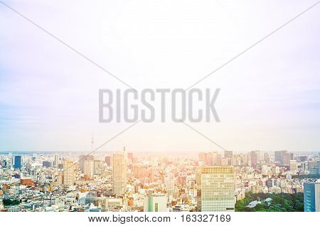 Asia Business concept for real estate and corporate construction - panoramic modern cityscape building bird eye aerial view of skytree under sunrise and morning blue bright sky in Tokyo Japan