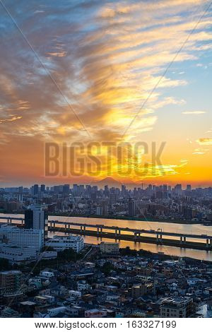 Asia Business concept for real estate and corporate construction - vertical modern cityscape building bird eye aerial view with Mount Fuji under sunrise and morning blue bright sky in TokyoJapan