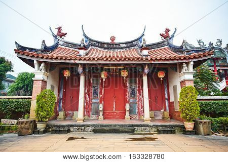 Traditional oriental temple with beautiful decoration in Taiwan (Chinese Translation on lantern:Jen-wen Academy on board:improve the society by education)