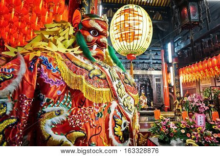 God statue in traditional old oriental chinese temple in Taiwan (Chinese Translation on lantern : name of the chinese god of sea mazu(matsu))