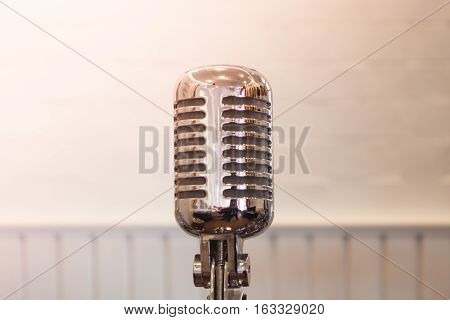 Vintage silver microphone with blurred background, stock photo