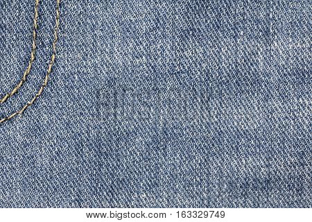 Denim jeans texture or denim jeans background with seam of jeans fashion design with copy space for text or image.