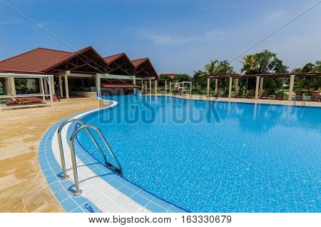 Holguing Province, playa Pesquero hotel, Cuba, Aug. 31, 2016, gorgeous amazing inviting view of swimming pool in tropical garden at premium service section on sunny day