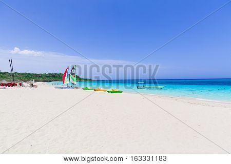 Holguing Province, Sol Rio de Luna y Mares, Cuba, Sep 1, 2016, nice amazing inviting view of white sand tropical beach with people relaxing in background on sunny day