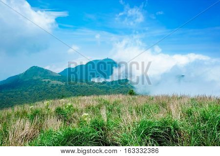 Panoramic bird eye aerial view of beautiful morning sunrise dramatic cloud of sea grassland under bright blue sky in Yangmingshan  (Yang ming Mountain) National Park in Taiwan