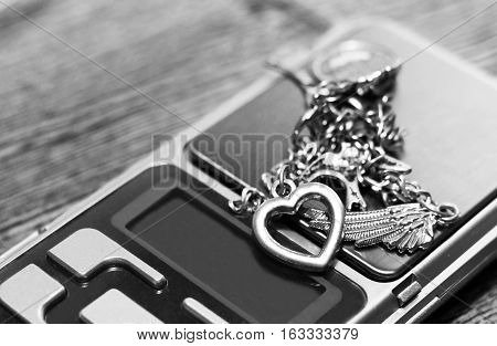 Tools of jewellery. Bracelet. On wooden background