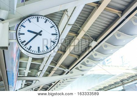 Clock at train or bts Station at day time.