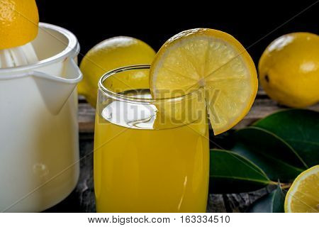 Squeezing lemon juice. Useful natural lemon juice
