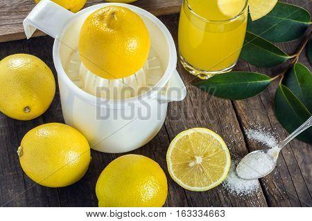 Squeezing lemon juice. Useful natural lemon juice