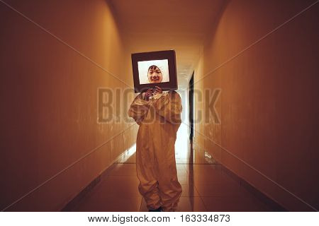 Korean little boy in space suite standing in narrow corridor