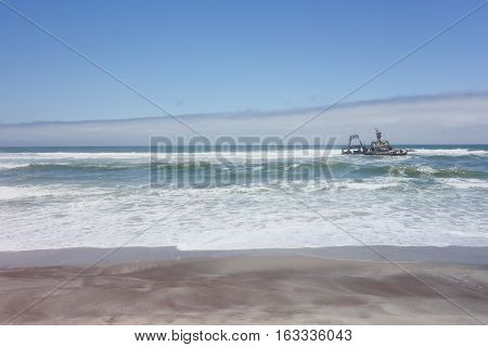 Shipwreck on Skeleton Coast Atlantic ocean in Namibia