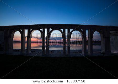 Sunset over the city lake in Bucharest. Port on Morii Lake Island