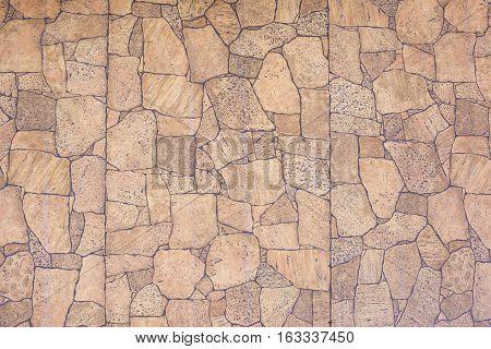 Wall imitation stones, unusual stonework, background, texture