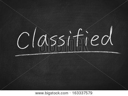 classified concept word on blackboard chalkboard background