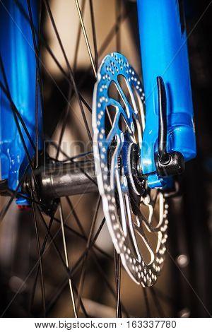 Blue bicycle front wheel disc brake .