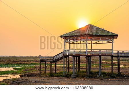 Dry or arid lake and old vintage pavilion with sunset light on the evening.